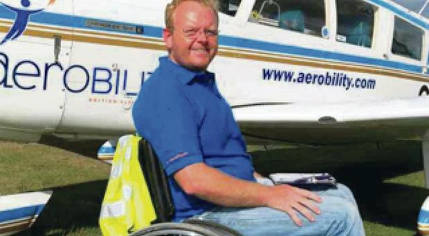Michael Holden with his specialist Aerobility aircraft