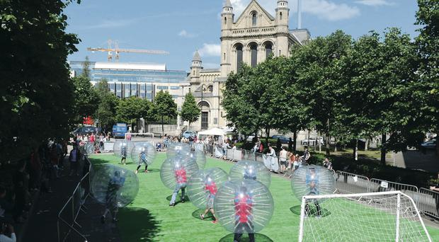 Bubble Football in Writers' Square, Belfast, yesterday. The bubble football was sponsored by the bar Aether & Echo on behalf of the Children's Heartbeat Trust