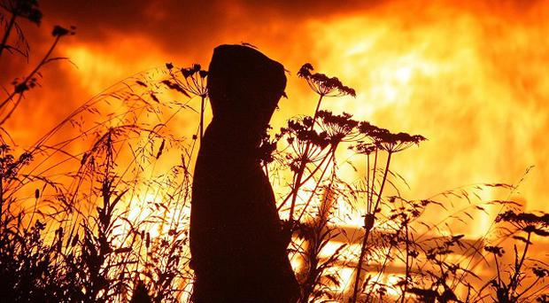 Bonfires are lit on the night before July 12 as part of the loyalist celebration