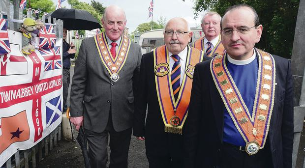 Senior members of the Orange Order, grand master Edward Stevenson, Belfast county master George Chittick, grand secretary Drew Nelson and deputy grand master Rev Alistair Smyth at the protest camp at Twaddell Avenue