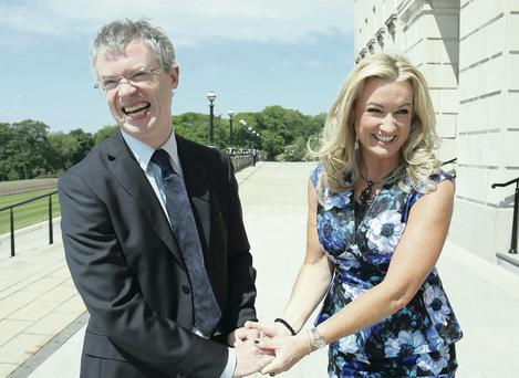 Ulster Unionist Jo-Anne Dobson greets former GAA star turned organ donor champion Joe Brolly at Stormont in June 2013