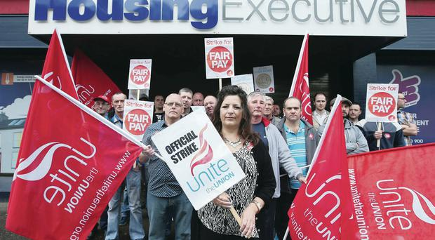 Unite regional officer Joanne McWilliams leads protesters outside the Housing Executive in Belfast yesterday