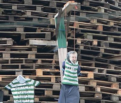 The effigy of Sinn Fein president Gerry Adams on a fake gallows on the Ballycraigy bonfire in Antrim