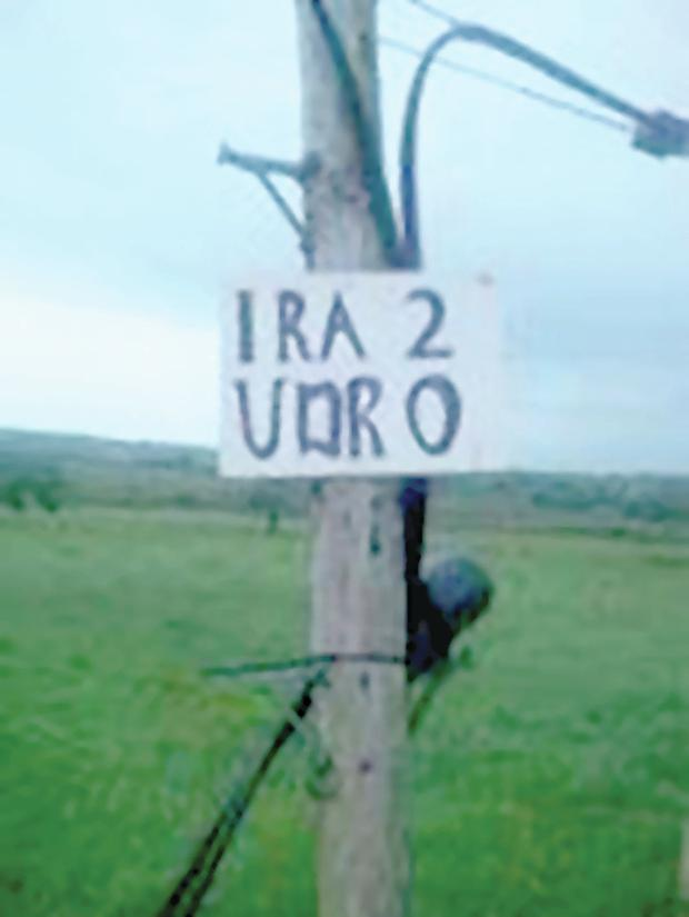 The insulting sign put up near the memorial to Heather Kerrigan and Norman McKinley, who died in an ambush at the site