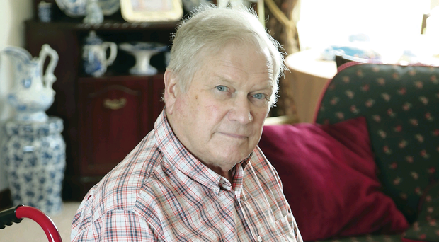 Wheelchair-bound Roy Patterson (79) has had his care hours cut each day and is struggling to cope