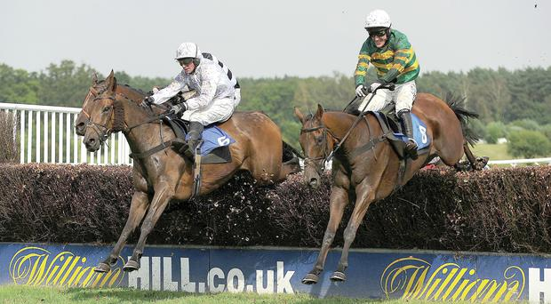 AP McCoy riding into the history books aboard It's A Gimme at Market Rasen on Saturday