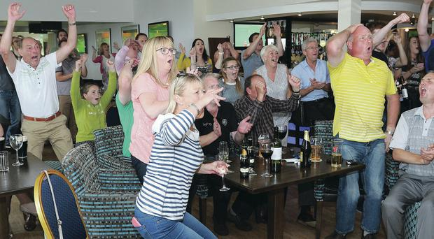 The agony and the ecstasy is etched on the faces of Holywood Golf Club members but finally they celebrate Rory McIlroy's third Major title in the Open Championship