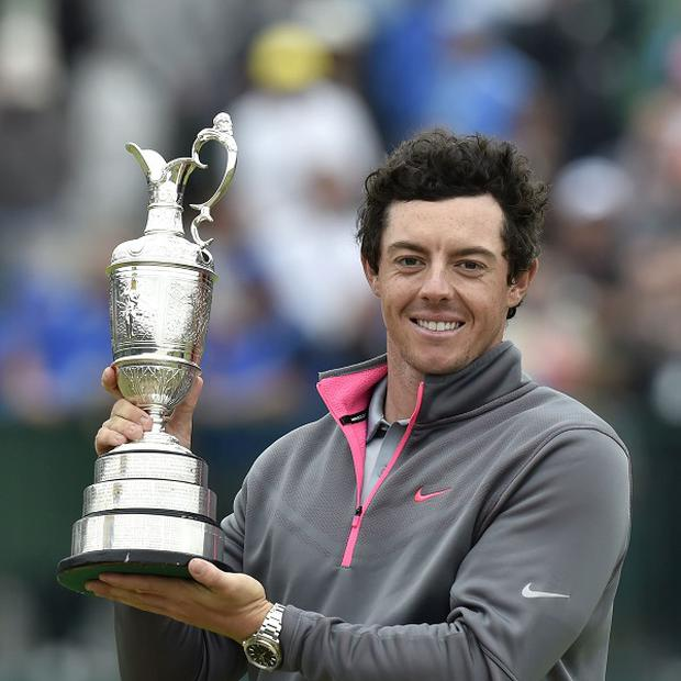 Rory McIlroy lifts the Claret Jug