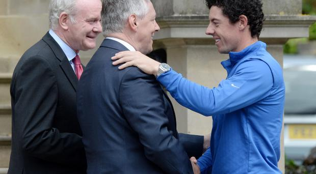 First Ministers Peter Robinson and Martin McGuinness greet Rory McIlroy at Stormont yesterday