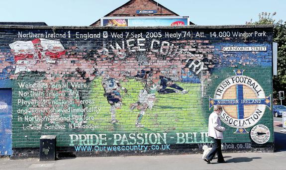 A mural in honour of David Healy's goal against England is barely recognisable on the Albertbridge Road in east Belfast