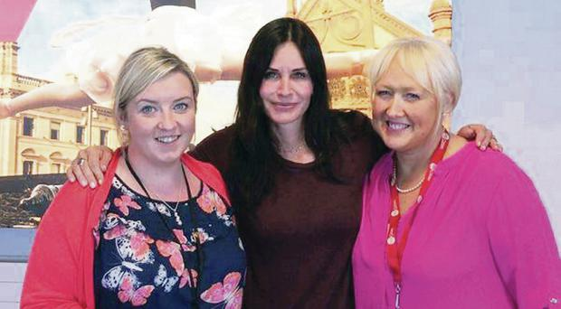 Courteney poses for a picture with Charlene Shongo and Siobhan McAnney