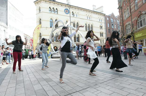 A multicultural flashmob in Corn Market promoting the annual Belfast Mela, which celebrates Indian food, music and culture