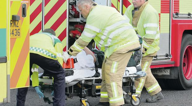 A PSNI officer is taken to hospital by paramedics after a police car and another vehicle collided