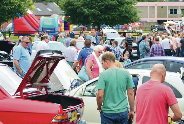 Visitors view the exhibits at Belfast Motor Show