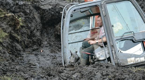 The digger is slowly sucked down into a bog in the Glenelly Valley, before being recovered thanks to the expertise of 82-year-old farmer Joe Rodgers