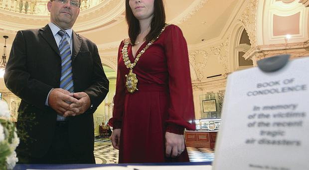 Lord Mayor of Belfast Nichola Mallon and Carson McMullan, honorary consul for The Netherlands, as a book of condolence was opened at Belfast City Hall in memory of the victims of three recent air disasters
