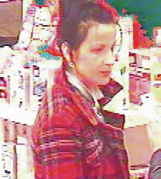 Police wish to speak to this woman wearing a red checked jacket and dark jeans in relation to a theft from Boots, Crescent Link, in Derry on February 12, 2014