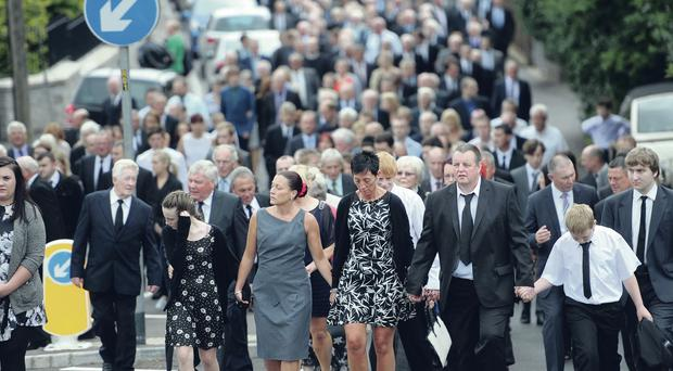 Family and friends pay their last respects to Oswald Bradley at his funeral yesterday