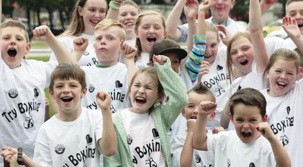 Kids enjoy the boxing on the big screen at Belfast's City Hall