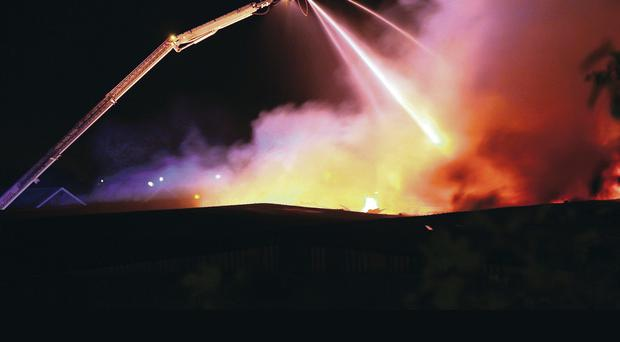 Fire crews dealing with a blaze at a disused factory in Bangor, Co Down. Photograph by Timothy Rooney