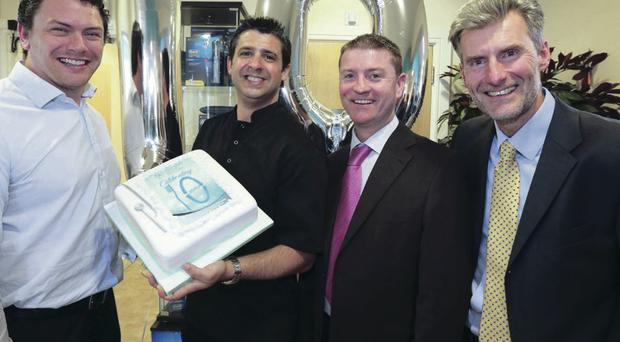 Simon Shane, Dentaquip, Philip McLorinan, Dunmurry Dental Practice, Kieran Farry, Henry Schein Dental and Tom Kennedy, Dentaquip, celebrate 10 years at the practice