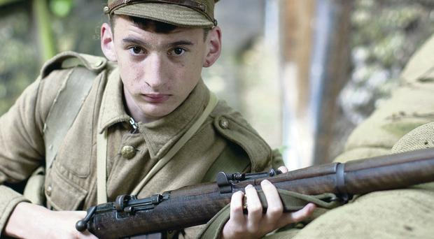 16-year-old Lee Dunion re-enacts the conditions in the trenches as a soldier in Thiepval Woods during the First World War