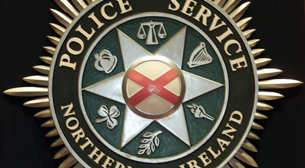 The Police Service of Northern Ireland is investigating after a pipe bomb was thrown at a car