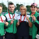 Boxers Steven Donnelly, Michaela Walsh, Sean Duffy, Alanna Audley-Murphy, Michael Conlan and Sean McGlinchy hold up their medals