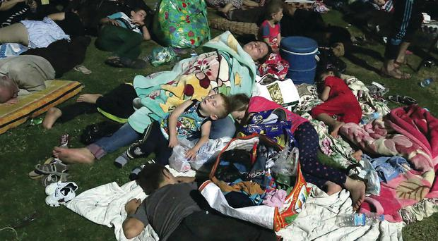 Christians fleeing the slaughter in Iraq sleep in the open air outside St Joseph's Church in Irbil