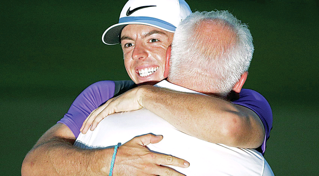 A hug for dad Gerry after his win