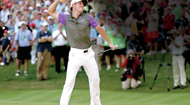 Rory McIlroy celebrates winning the US PGA on Sunday
