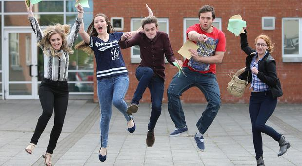 Students at St Paul's High School, Bessbrook, Co Armagh, receive their A-level results