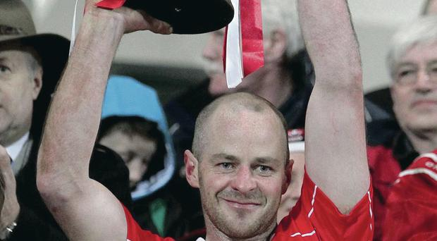 Kevin McCloy lifts the McKenna Cup for Derry in 2011