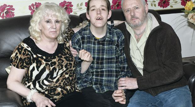 Margaret and Raymond Butler with son Steven at their Bangor home