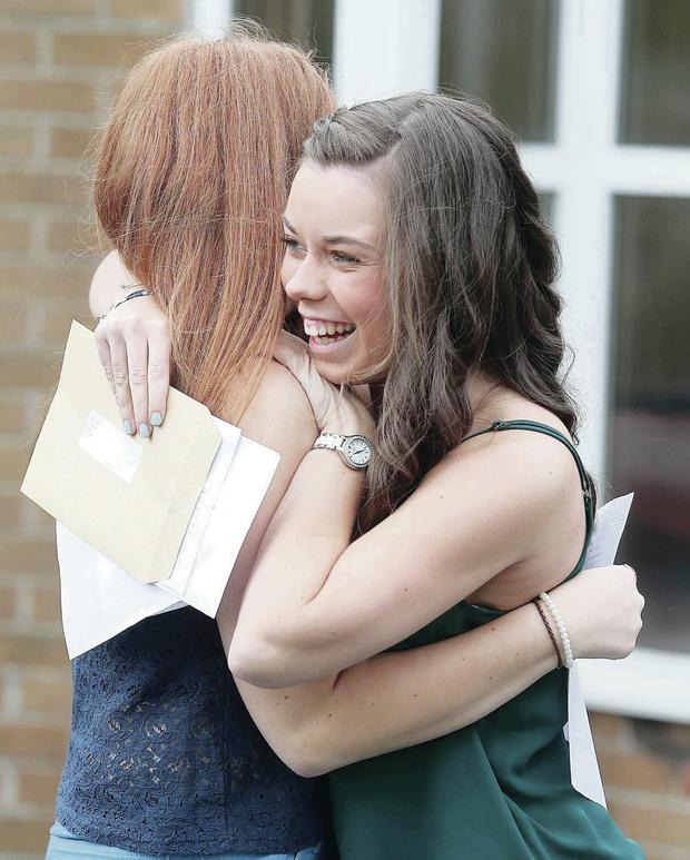 Bloomfield Collegiate students Victoria Bates (left) and Abbie Hearte embrace after receiving their results yesterday