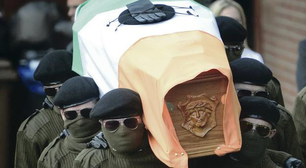 A paramilitary guard during the funeral of veteran IRA volunteer Tony Catney in west Belfast