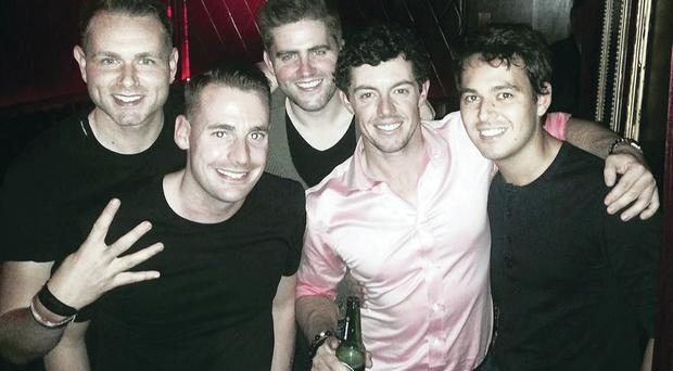 In the pink: Rory celebrating with close friends