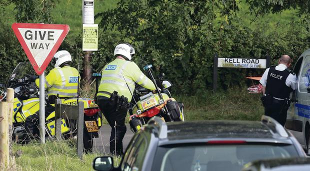 Police at the scene of the crash near Fivemiletown, Co Tyrone, where a competitor in the Ulster Rally died