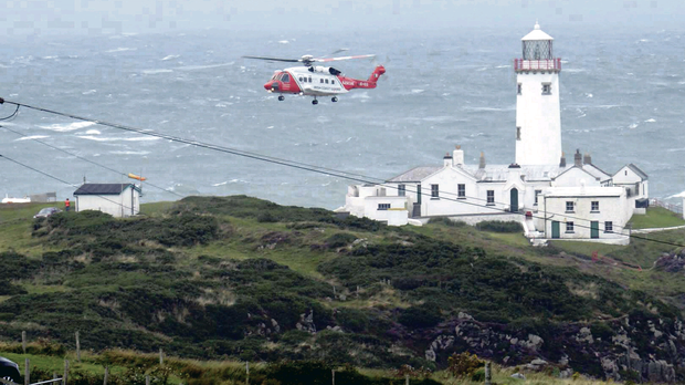 An Irish Coastguard helicopter hovers over the scene of the tragic accident at Fanad Lighthouse
