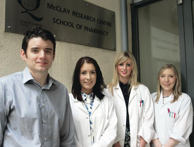 Research team leader Dr Garry Laverty and PhD student Alice McCloskey (right), who was named on the research paper. Included are summer students Sophie Watterson (second left) and Sophie Gilmore
