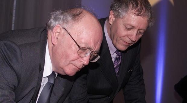 Sam Foster, left, pictured in 2002. He has died aged 82