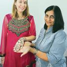 Belfast Telegraph reporter Rebecca Black with executive director of Arts Ekta and founder of Mela, Nisha Tandon