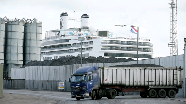 The Rotterdam cruise ship docked at Belfast yesterday beside a coal depot