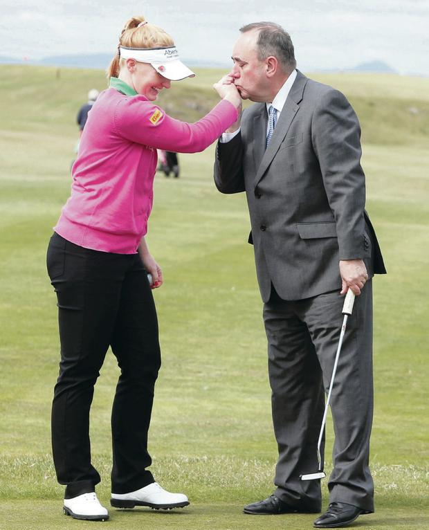 Alex Salmond, currently campaigning for a Yes vote, with professional golfer Kylie Walker at North Berwick Golf Club yesterday