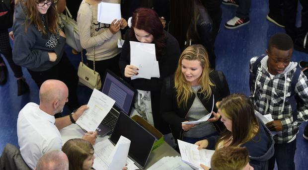 Pupils collect their GCSE results at Perry Beeches The Academy in Birmingham