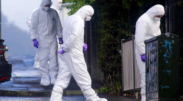 Police officers at the scene in the Ballysillan area of north Belfast where John Boreland was shot. Pic Kevin Scott