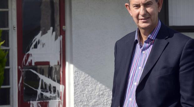 Edwin Poots visits the home at Dunbeg Park in Hillsborough where white paint was thrown at the front door in a racist attack