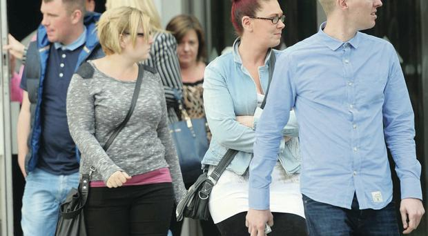 Family and friends of John Bunting and John Howcroft leave Laganside Court after Saturday's hearing