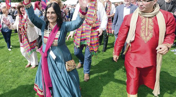 Nisha Tandon and the DUP's Jonathan Bell (white shirt) lead the procession at the Belfast Mela