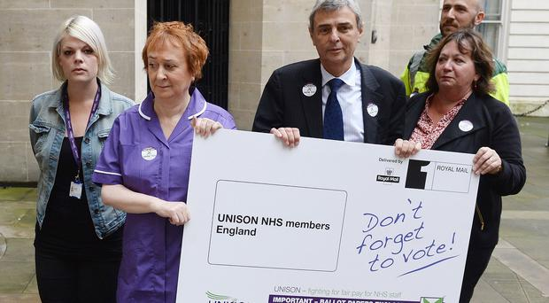 Health worker Mary Locke, in purple, accompanies Unison general secretary Dave Prentis to deliver a giant strike ballot envelope to the Department of Health
